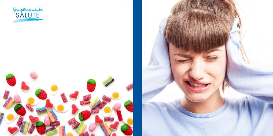 caramelle e donna con il mal di testa